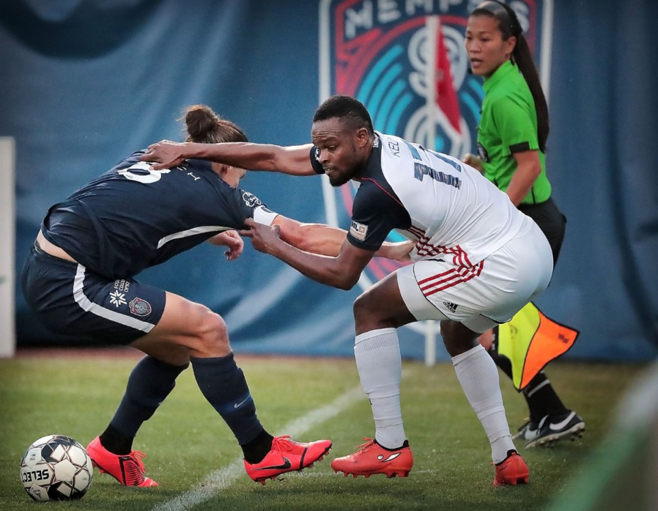 <strong>Memphis defender Marc Burch (8) battles for possession of the ball with Indy Eleven defender Dane Kelly (17) during 901 FC's 3-0 loss to Indianapolis at AutoZone Park on June 8, 2019.</strong> (Jim Weber/Daily Memphian file)