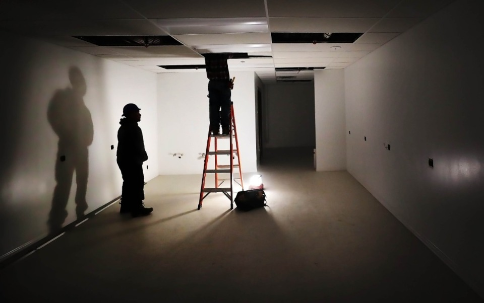 <strong>Construction crews work on lighting for the dressing rooms on Feb. 27, 2020, as Theatre Memphis undergoes a multimillion dollar renovation.&nbsp;</strong>(Jim Weber/Daily Memphian)
