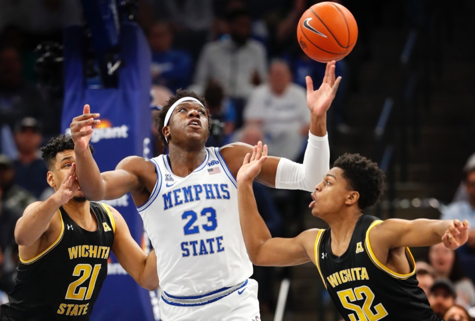 <strong>Memphis center Malcolm Dandridge (middle) grabs a loose ball away from Wichita State defenders Jaime Echenique (left) and Grant Sherfield (right) hursday, March 5, 2020 at FedExForum.</strong> (Mark Weber/Daily Memphian)
