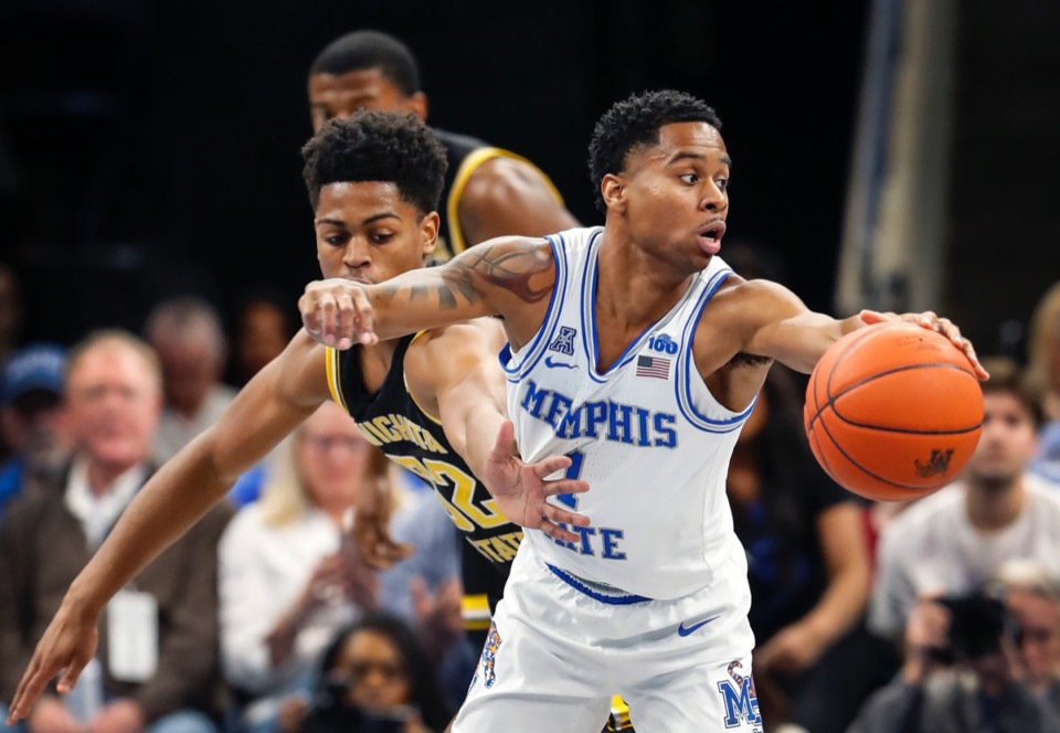 <strong>Memphis guard Tyler Harris (right) moves the ball away from Wichita State defender Grant Sherfield (left) Thursday, March 5, 2020 at FedExForum.</strong> (Mark Weber/Daily Memphian)
