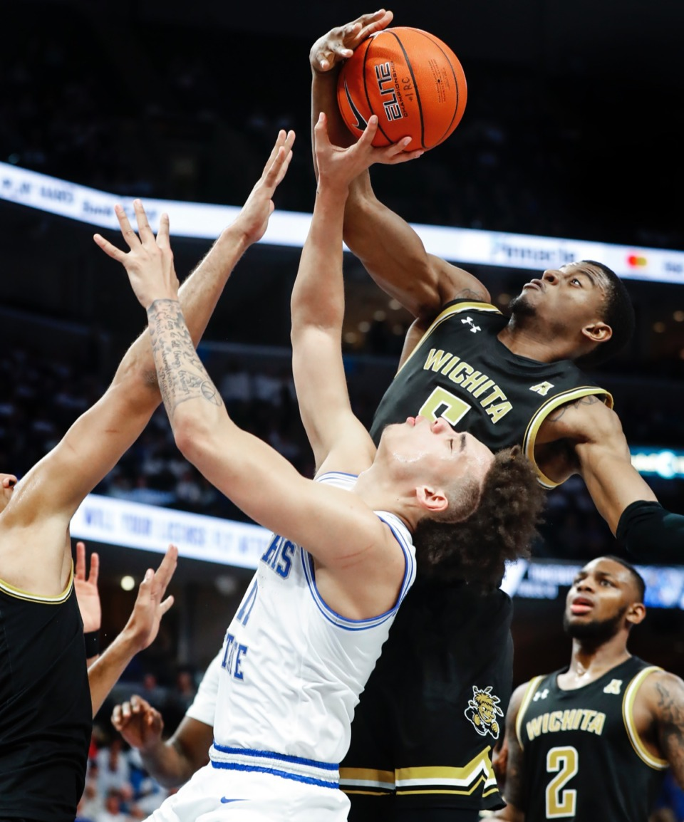 <strong>Memphis guard Lester Quinones (bottom) is fouled while driving the lane against Wichita State's Trey Wade (top) Thursday, March 5, 2020, at FedExForum.</strong> (Mark Weber/Daily Memphian)