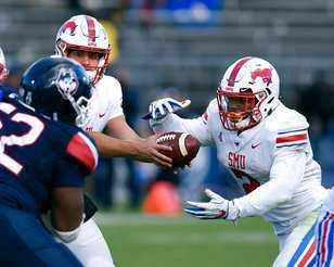 <span>SMU quarterback Ben Hicks (8) hands off to running back Ke'Mon Freeman (2) in last Saturday's game against Connecticut.&nbsp;(AP Photo/Stephen Dunn)</span>