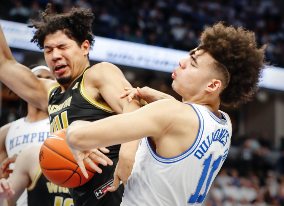 <strong>Memphis guard Lester Quinones (right) is fouled by Wichita State's Isaiah Poor Bear-Chandler (left) March 5, 2020, at FedExForum.</strong> (Mark Weber/Daily Memphian)