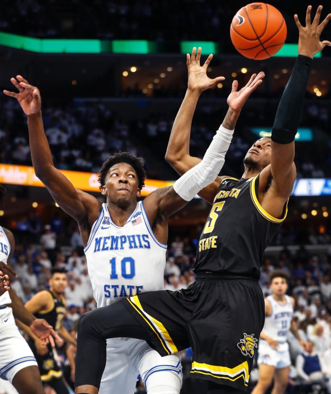 <strong>Memphis guard Damion Baugh (left) battles Wichita State guard Trey Wade (right) for a loose ball March 5, 2020, at FedExForum.</strong> (Mark Weber/Daily Memphian)