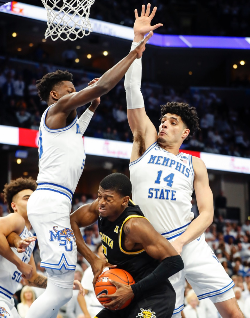 <strong>Memphis defenders Damion Baugh (left) and Isaiah Maurice (right) apply pressure to Wichita State guard Trey Wade (middle) March 5, 2020, at FedExForum.</strong> (Mark Weber/Daily Memphian)