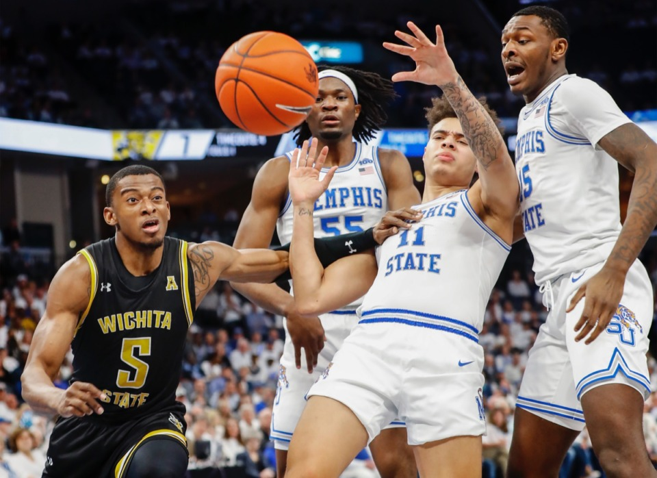 <strong>Wichita State guard Trey Wade (left) is called for a foul after pushing Memphis defender Lester Quinones (middle right) March 5, 2020 at the FedExForum.</strong> (Mark Weber/Daily Memphian)