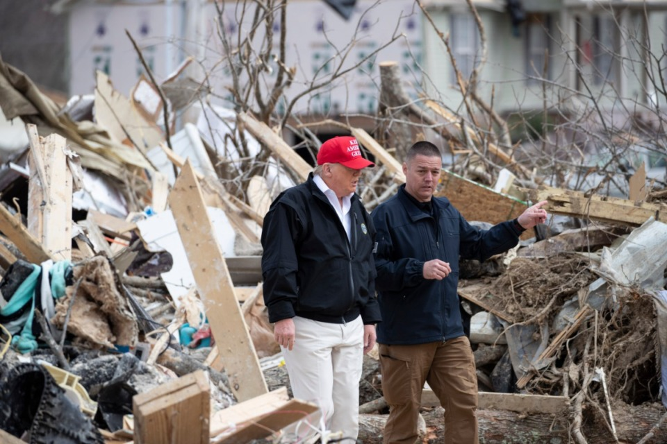 <strong>President Donald Trump speaks Mike Herrick, with Putnam County Rescue Squad, as he tours damage from a recent tornado, Friday, March 6, 2020, in Cookeville.</strong> (AP Photo/Alex Brandon)