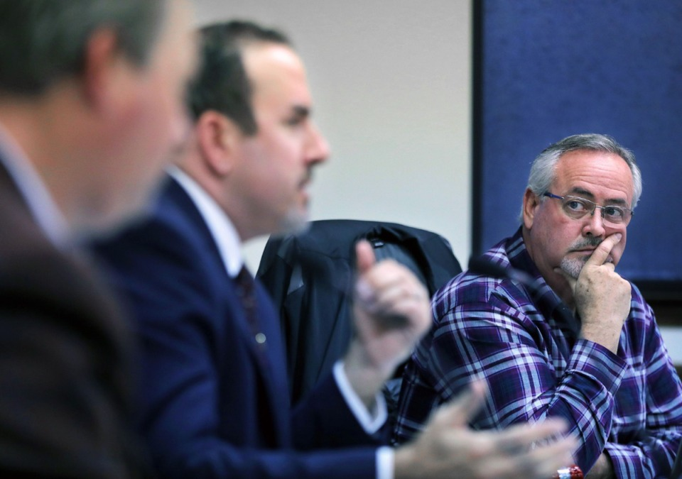 <strong>Lakeland Mayor Mike Cunningham listens to commissioner Wesley Wright during a Board of Commissioners work session Thursday, March 5, at Lakeland City Hall. Cunningham had requested a state review last April, citing what he termed &ldquo;numerous questionable financial anomalies&rdquo; in city records.</strong> (Patrick Lantrip/Daily Memphian)