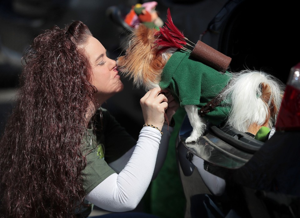 <strong>Heather Lampi gets some affection from her papillon Atlas while dressing him as Robin Hood before the start of a Mardi Growl dog party at Overton Park on March 7, 2020. The event included a costume contest and parade hosted by the Overton Park Conservancy and Hollywood Feed.</strong> (Jim Weber/Daily Memphian)