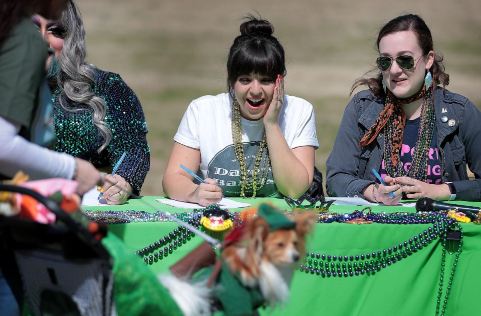 <strong>Markie Maloof (center) reacts to the cuteness of a tiny dog dressed as Robin Hood as she judges the costume contest with Lucy Furr (left) and Claire Brulatour during a&nbsp;Mardi Growl dog party at Overton Park on March 7, 2020. The event included a costume contest and parade hosted by the Overton Park Conservancy and Hollywood Feed. </strong>(Jim Weber/Daily Memphian)