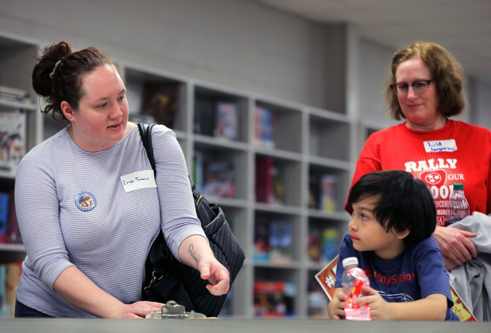 <strong>Erica Tamariz's (left) son Dorian watches her sign up be a delegate picker during a convention at Kirby High School on March 7, 2020, to decide who will be the official delegates from Shelby County to this summer's Democratic National Convention in Milwaukee.</strong> (Patrick Lantrip/Daily Memphian)