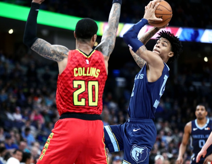 <strong>Memphis Grizzlies guard Ja Morant (12) drives to the basket during a March 7, 2020, game at FedExForum against the Atlanta Hawks.</strong> (Patrick Lantrip/Daily Memphian)