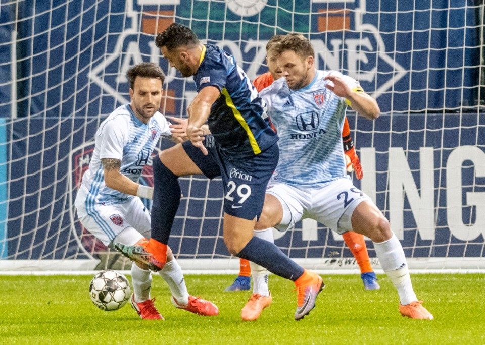 <strong>Memphis 901 FC forward Brandon Allen scores an early goal against Indy Eleven defenders Ayoze Garcia and Paddy Barrett at AutoZone Park Saturday, March 7, 2020. Despite the early lead, Memphis lost 4-2 in their season-opening match.</strong> (Greg Campbell/Special to The Daily Memphian)