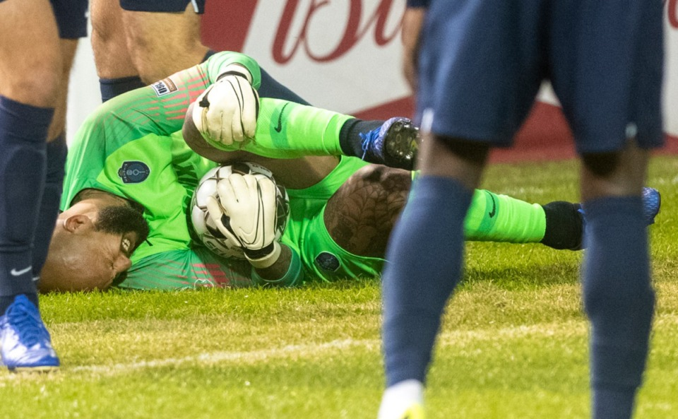 <strong>Memphis 901 FC goalie Tim Howard grimaces in pain after being kicked when stopping a goal against Indy Eleven during the season opener at AutoZone Park Saturday, March 7, 2020.</strong> (Greg Campbell/Special to The Daily Memphian)