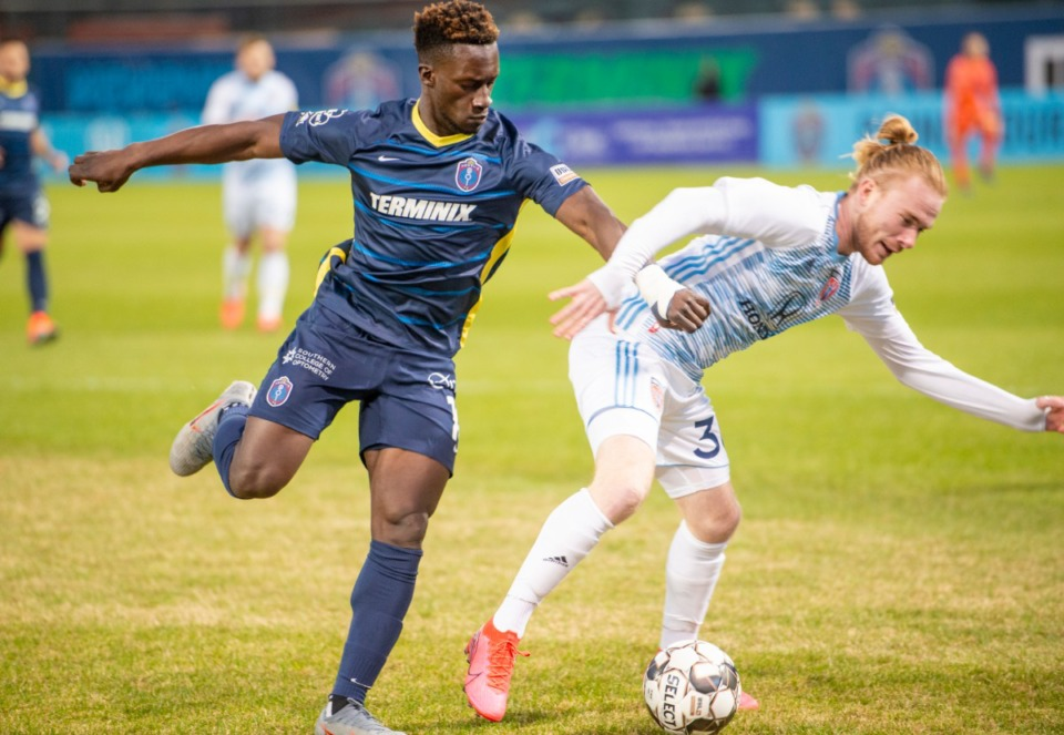 <strong>Memphis 901 FC Midfielder Jean-Christophe Koffi fends off Indy Eleven midfielder Andrew Carleton during the season opener at AutoZone Park Saturday, March 7, 2020.</strong> (Greg Campbell/Special to The Daily Memphian)