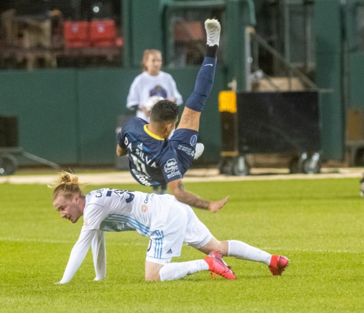 <strong>Indy Eleven midfielder Andrew Carleton undercuts Memphis 901 FC forward Pierre da Silva in the season opener at AutoZone Park Saturday, March 7, 2020. Indy scored 3 goals in the final period to overtake Memphis 4-2.</strong> (Greg Campbell/Special to The Daily Memphian)