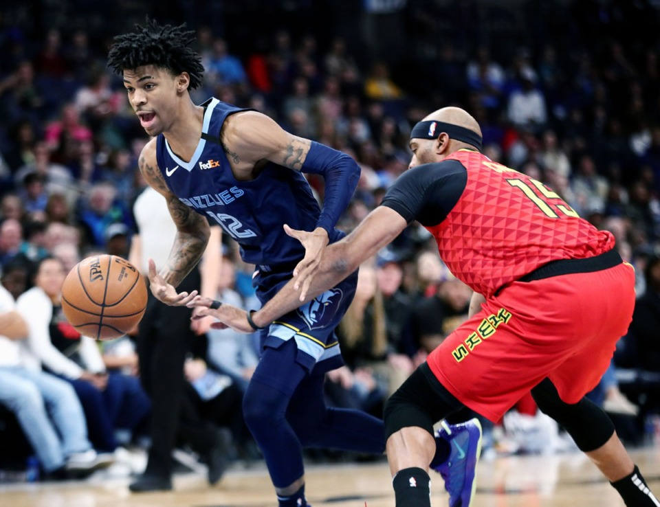 <strong>Memphis Grizzlies guard Ja Morant (12) is fouled by Vince Carter (15) during a March 7, 2020, game at FedExForum against the Atlanta Hawks.</strong> (Patrick Lantrip/Daily Memphian)