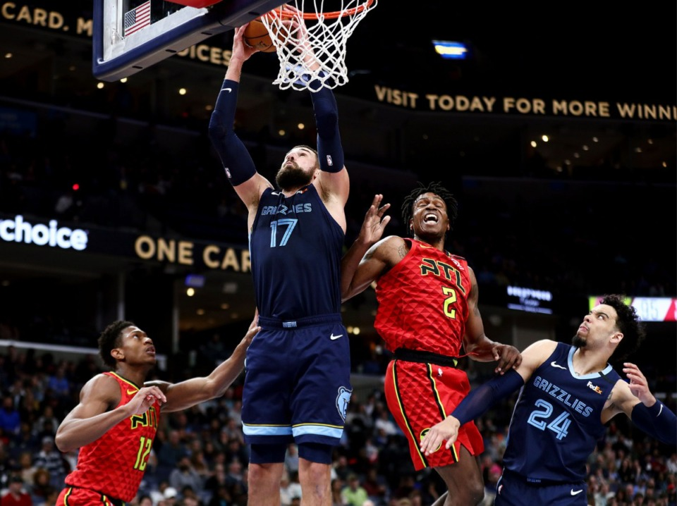 <strong>Memphis Grizzlies center Jonas Valanciunas (17) grabs a rebound during a March 7, 2020, game at FedExForum against the Atlanta Hawks.</strong> (Patrick Lantrip/Daily Memphian)