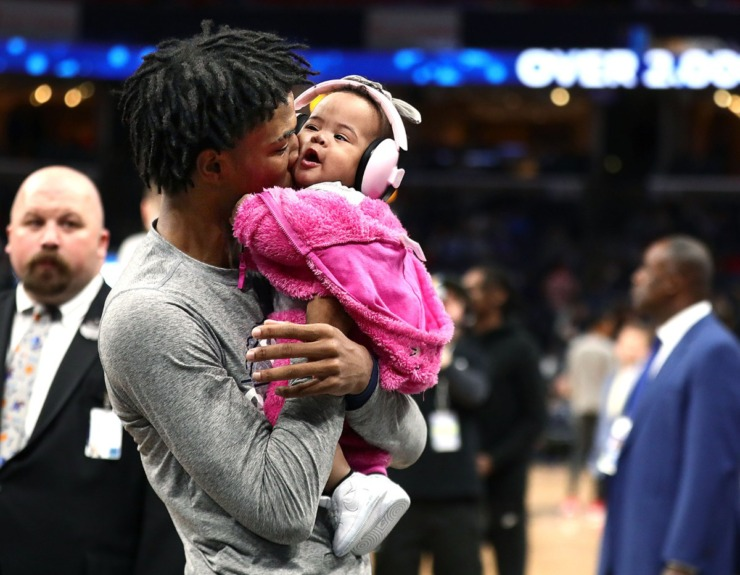 <strong>Memphis Grizzlies guard Ja Morant (12) kisses his daughter before a March 7, 2020, game at FedExForum against the Atlanta Hawks.</strong> (Patrick Lantrip/Daily Memphian)
