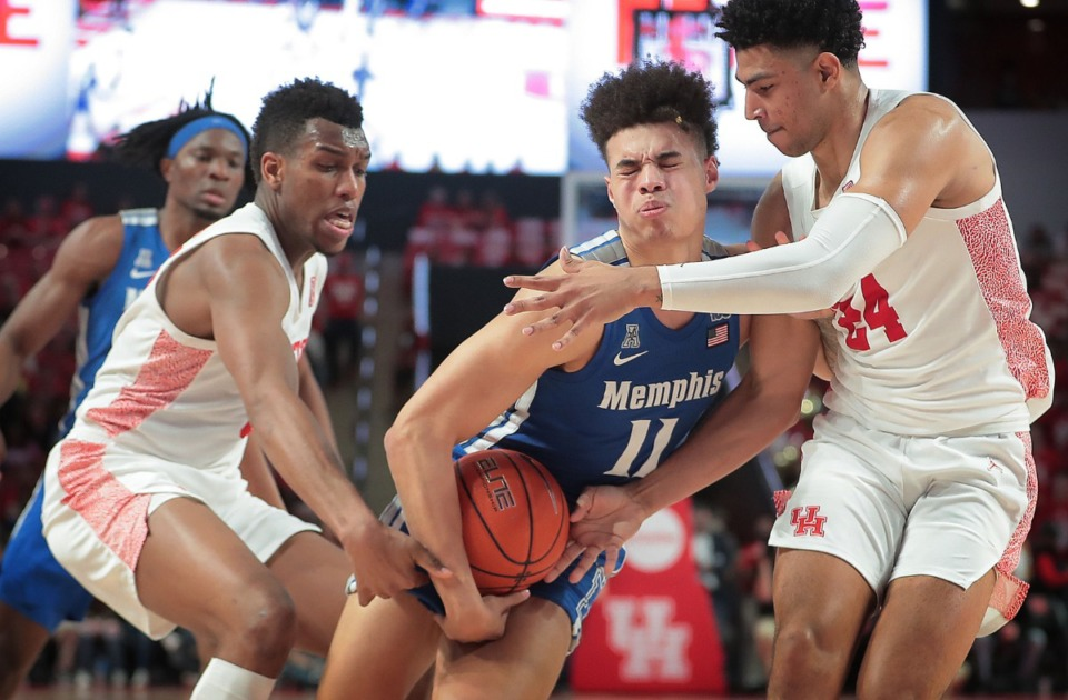 <strong>University of Memphis guard Lester Quinones (11) is fouled on a drive by Houston's Quentin Grimes (right) during the Tigers' game against the Cougars at the Fertitta Center in Houston on March 8, 2020.</strong> (Jim Weber/Daily Memphian)