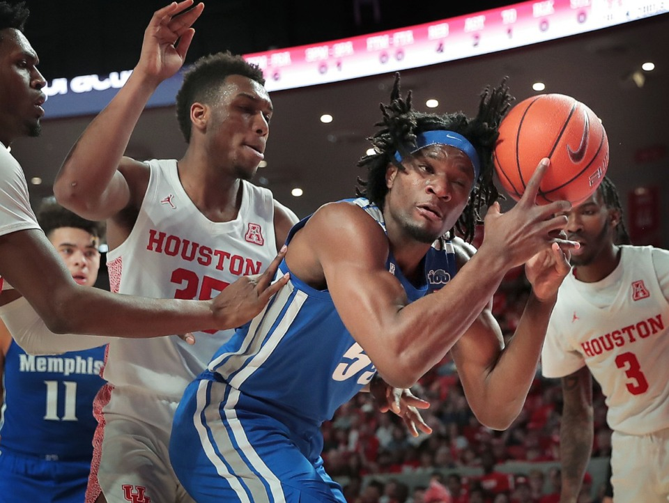 <strong>University of Memphis forward Precious Achiuwa tries to control a rebound under pressure by Houston's Fabian White (35) during the Tigers' game against the Cougars at the Fertitta Center in Houston on March 8, 2020.</strong> (Jim Weber/Daily Memphian)