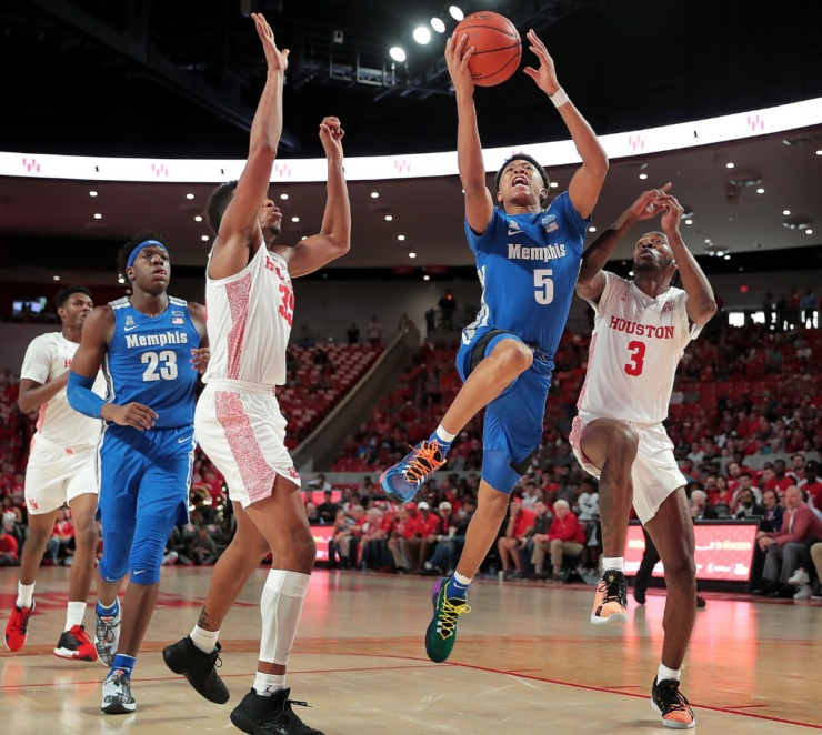 <strong>University of Memphis guard Boogie Ellis shoots under pressure by Houston's DeJon Jarreau (3) and Fabian White (35) during the Tigers' game against the Cougars at the Fertitta Center in Houston on March 8, 2020.</strong> (Jim Weber/Daily Memphian)