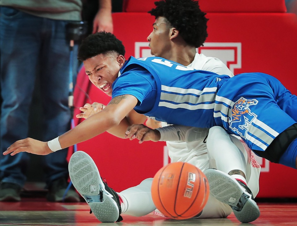 <strong>University of Memphis guard Boogie Ellis collides with Houston's Nate Hinton during the Tigers' game against the Cougars at the Fertitta Center in Houston on March 8, 2020.</strong> (Jim Weber/Daily Memphian)