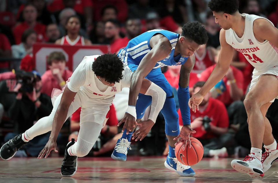<strong>University of Memphis guard Damion Baugh (10) battles for a loose ball with Houston's Nate Hinton (left) during the Tigers' game against the Cougars at the Fertitta Center in Houston on March 8, 2020.</strong> (Jim Weber/Daily Memphian)