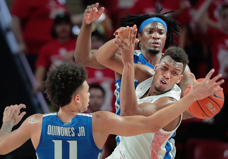 <strong>University of Memphis guard Lester Quinones (11) and forward Precious Achiuwa battle for a rebound with Houston's Fabian White (35) during the Tigers' game against the Cougars at the Fertitta Center in Houston on March 8, 2020.</strong> (Jim Weber/Daily Memphian)