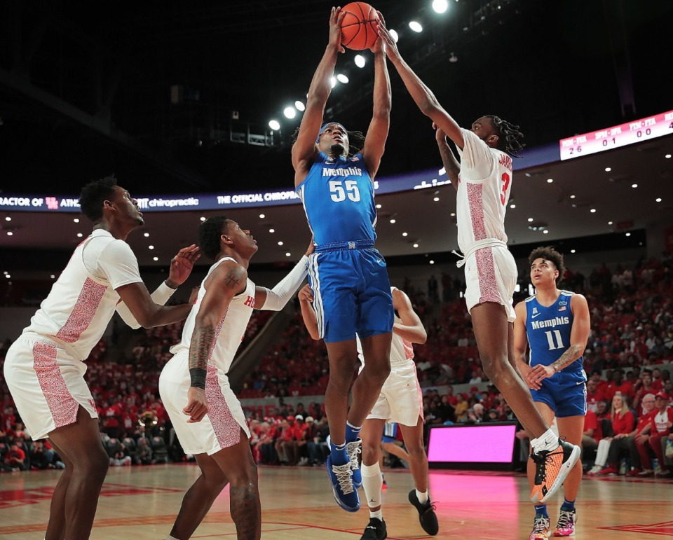 <strong>University of Memphis forward Precious Achiuwa (55) shoots under pressure by Houston's DeJon Jarreau (3) during the Tigers' game against the Cougars at the Fertitta Center in Houston on March 8, 2020.</strong> (Jim Weber/Daily Memphian)
