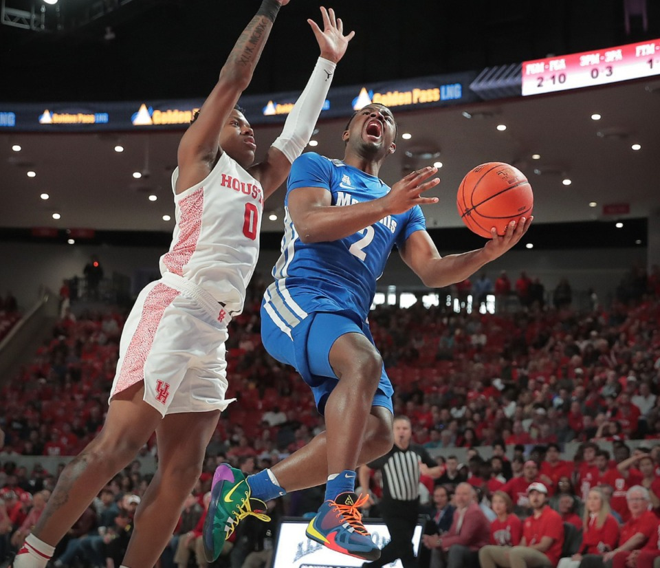 <strong>University of Memphis guard Alex Lomax (2) shoots under pressure by Houston's Marcus Sasser (0) during the Tigers' game against the Cougars at the Fertitta Center in Houston on March 8, 2020.</strong> (Jim Weber/Daily Memphian)