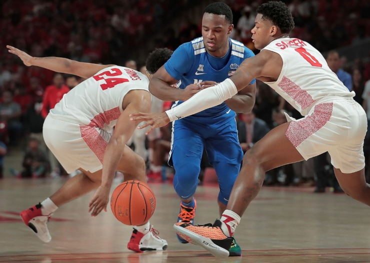 <strong>University of Memphis guard Alex Lomax (center) makes a drive under pressure by Houston's Marcus Sasser (0) and Quentin Grimes (24) during the Tigers' game against the Cougars at the Fertitta Center in Houston on March 8, 2020.</strong> (Jim Weber/Daily Memphian)