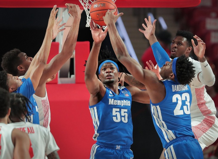 <strong>University of Memphis forward Precious Achiuwa (55) and forward Malcolm Dandridge (23) stretch for a rebound under pressure by Houston's Chris Harris Jr. (right) and Fabian White (left) during the Tigers' game against the Cougars at the Fertitta Center in Houston on March 8, 2020.</strong> (Jim Weber/Daily Memphian)