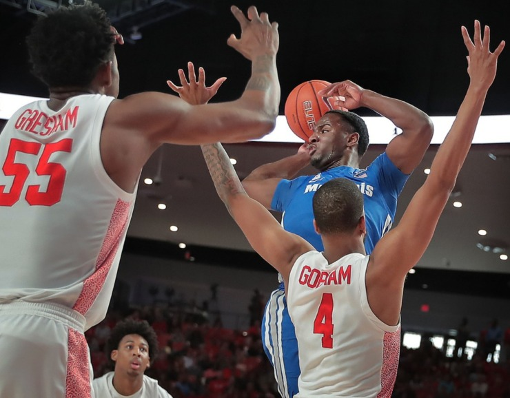 <strong>University of Memphis guard Alex Lomax looks for an open man under pressure by Houston's Justin Gorham (4) during the Tigers' game against the Cougars at the Fertitta Center in Houston on March 8, 2020.</strong> (Jim Weber/Daily Memphian)