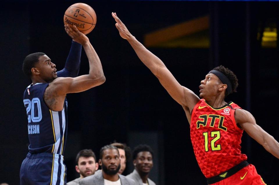 <strong>Memphis Grizzlies guard Josh Jackson (20) shoots against Atlanta Hawks forward De'Andre Hunter (12) in the first half of an NBA basketball game Saturday, March 7, 2020, in Memphis, Tenn.</strong> (AP Photo/Brandon Dill)