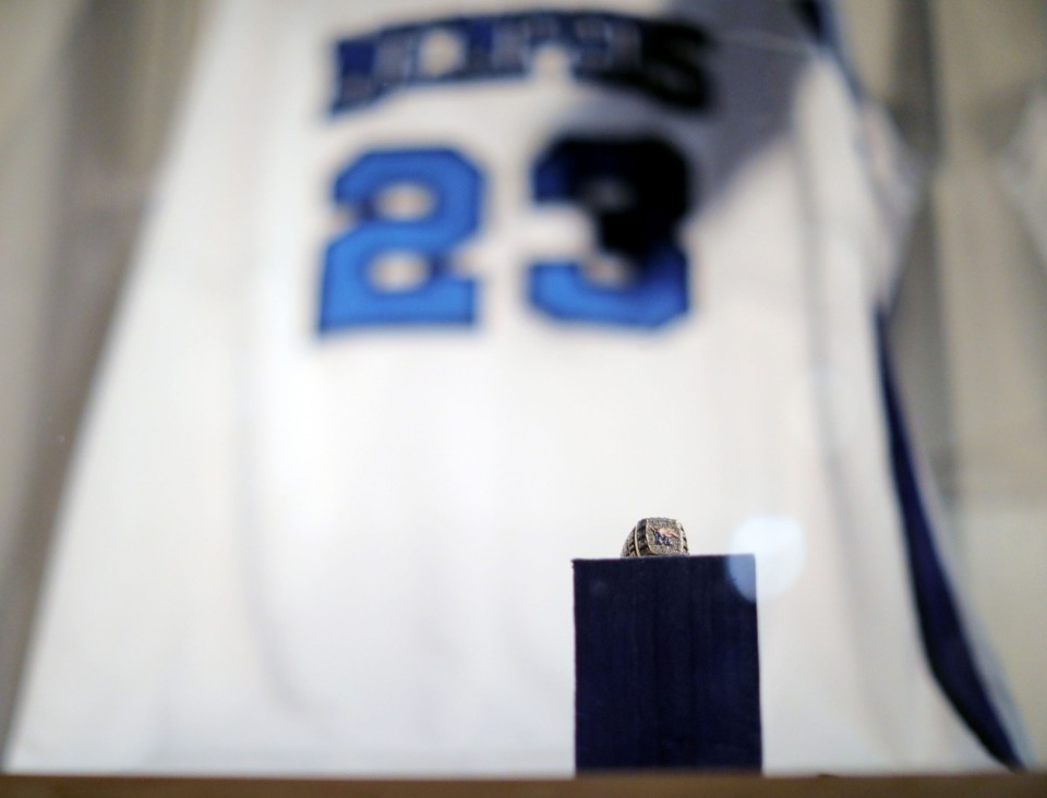 <strong>A Conference USA championship ring sits in front of a Derrick Rose jersey at the Pink Palace exhibit.</strong> (Patrick Lantrip/Daily Memphian)