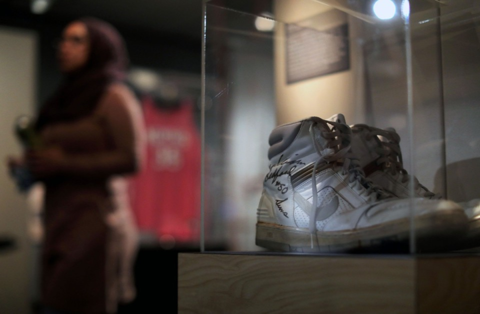 <strong>A signed pair of William Bedford's shoes are on display at the Pink Palace Museum's new exhibit on the history of the University of Memphis men's and women's basketball programs.</strong> (Patrick Lantrip/Daily Memphian)