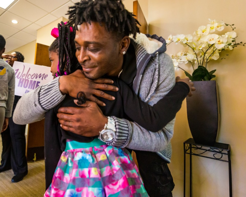 <strong>Church greeter Julius Payne welcomes Erin Payne and family with a hug at Pursuit of God Church on March 8, 2020 in Frayser.</strong> (Ziggy Mack/Special to The Daily Memphian)
