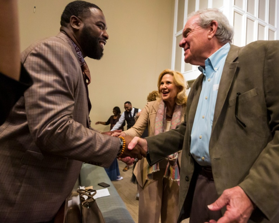 <strong>Church members (left to right, Thomas Glaspie and John Williams) from Bellevue and Pursuit of God churches greet each other during a sermon at Pursuit of God Church on March 8, 2020 in Frayser.&nbsp;</strong>(Ziggy Mack/Special to The Daily Memphian)