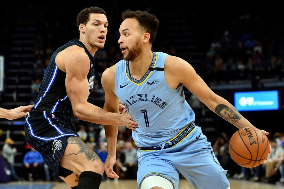 <strong>Memphis Grizzlies forward Kyle Anderson (1) drives against Orlando Magic forward Aaron Gordon</strong>&nbsp;<strong>on March 10, 2020, at FedExForum.</strong> (Brandon Dill/AP)