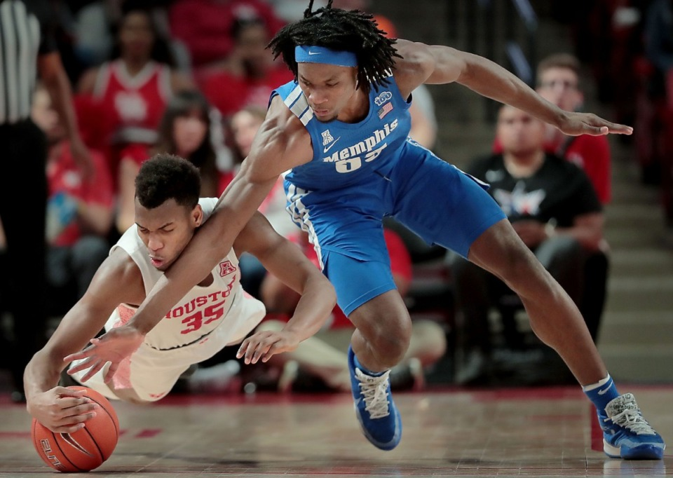 <strong>University of Memphis forward Precious Achiuwa tries to make a steal from Houston's Fabian White (35) during the Tigers' game against the Cougars at the Fertitta Center in Houston on March 8, 2020.</strong> (Jim Weber/Daily Memphian)