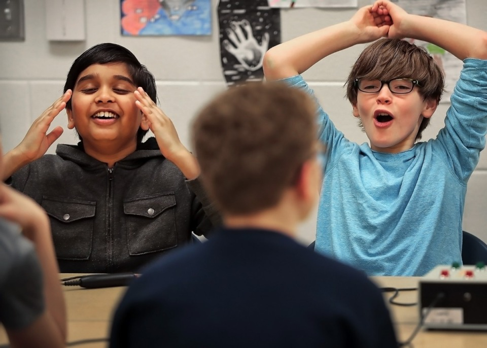 <strong>Quiz Bowl team members Akhil Durgam (left) and Cullen Hutchens react to a missed question about American poetry during practice before school on Wednesday, March 11, at Lakeland Middle Preparatory School. Quiz Bowl is one of the new extracurricular activities that started this year, along with the Robotics Club and Swim Team.</strong> (Jim Weber/Daily Memphian)