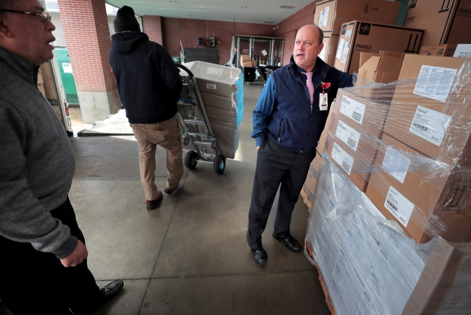 <strong>Le Bonheur Children's Hospital Environmental Services Director Shane Fulford (right) checks out a shipment of cleaning supplies being delivered by Charles Barnes' (left) Action Janitorial supply company on Feb. 26, 2020. The Methodist Hospitals have been trying to increase the amount they spend with minority vendors.</strong> (Jim Weber/Daily Memphian)