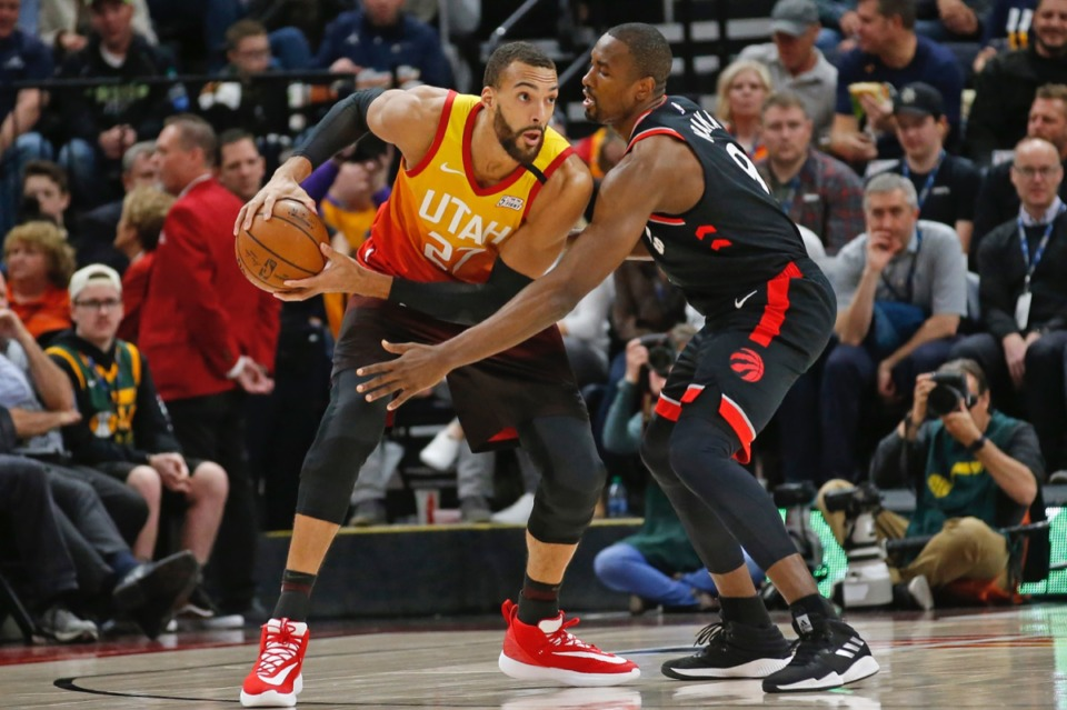 """<strong>Utah Jazz center Rudy Gobert (right), seen here March 9, 2020, in Salt Lake City, tested a """"preliminary"""" positive for COVID-19, according to a league release. The Jazz were scheduled to play the Thunder in Oklahoma City tonight.&nbsp;</strong>(Rick Bowmer/AP)"""