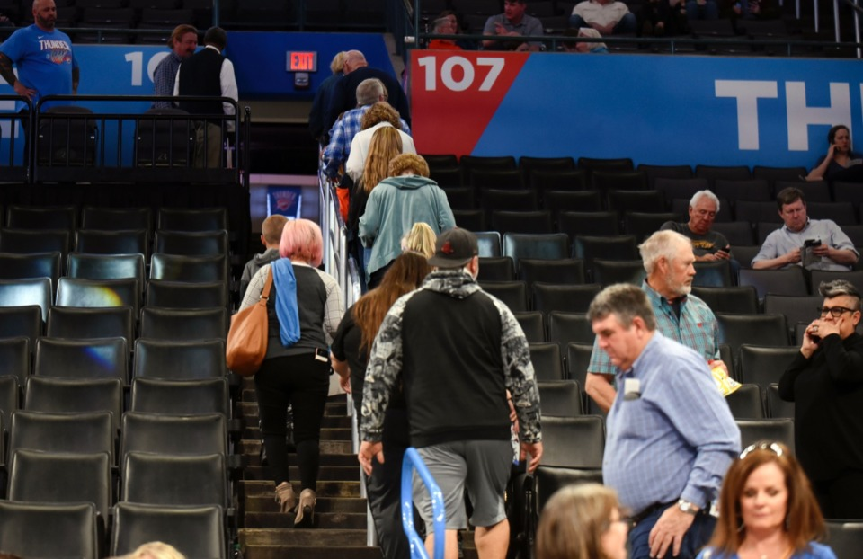 <strong>Basketball fans leave Chesapeake Energy Arena after it is announced that an NBA basketball game between the Thunder and the Utah Jazz in Oklahoma City has been postponed, along with the entire NBA season, on Wednesday, March 11, 2020.</strong> (Kyle Phillips/AP)