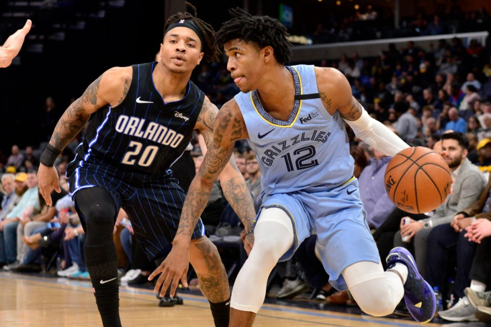 <strong>Memphis Grizzlies guard Ja Morant (12) is defended by Orlando Magic guard Markelle Fultz (20) during the first half of an NBA basketball game Tuesday, March 10, 2020, in Memphis, Tennessee.</strong> (AP Photo/Brandon Dill)