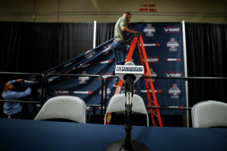 <strong>Dickies Arena workers work on a backdrop moments after American Athletic Conference officials announced the cancellation of the men's conference basketball tournament on Thursday, March 12, 2020 in Fort Worth, Texas.</strong>&nbsp;(Mark Weber/Daily Memphian)