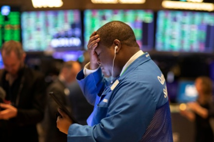 <strong>Stock trader Thomas Lee works at the New York Stock Exchange on March 13, 2020. Stocks opened sharply higher on Wall Street a day after the worst drop since 1987.</strong> (AP Photo/Mark Lennihan)