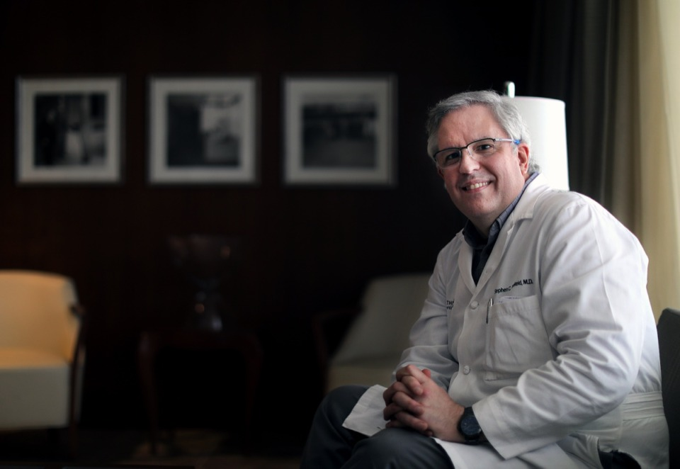 <strong>Dr. Stephen Threlkeld, an infectious disease specialist, poses for a portrait in the boardroom at Baptist Memorial Healthcare's headqarters on North Humphreys on March 13, 2020.</strong> (Patrick Lantrip/Daily Memphian)