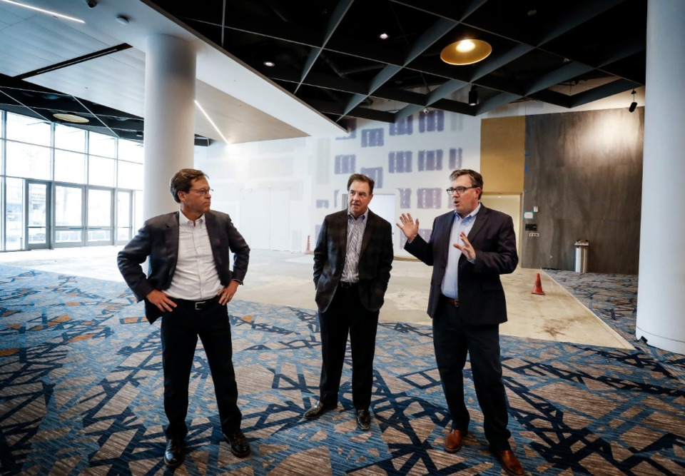 <strong>MFA partners (left to right) Scott Fleming, Tom Marshall and Alan Barner discuss upgrades that have been completed inside the Renasant Convention Center on Monday, March 9, 2020.</strong> (Mark Weber/Daily Memphian)